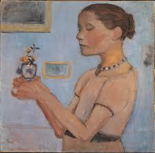 jeune fille tenant des fleurs jaunes dans un verre